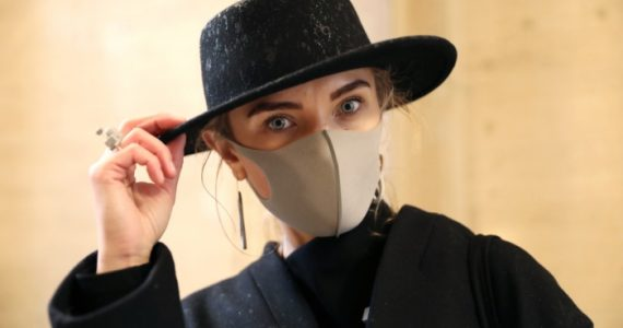 Gerda Liudvinaviciute, from Lithuania, wears a face mask and kARTu clothing during the Fashion Scout as part of the London Fashion Week February 2020 show at Victoria House, Bloomsbury, London. (Photo by Isabel Infantes/PA Images via Getty Images)