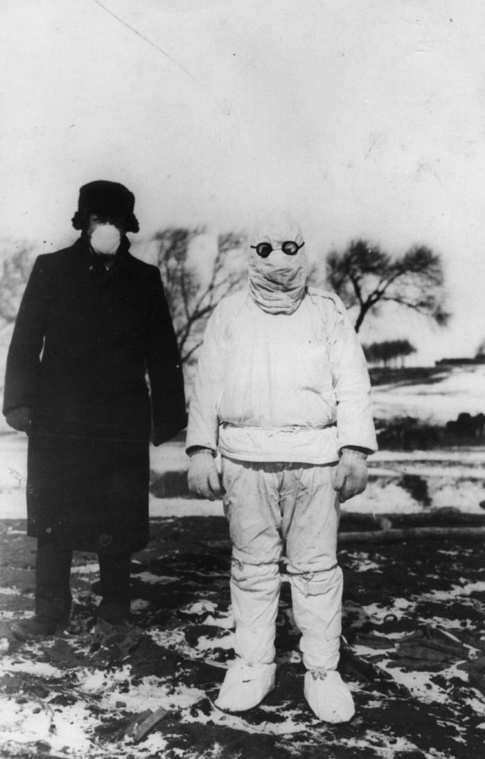 1912: A doctor wears protective clothing during an outbreak of plague in Manchuria. (Photo by Hulton Archive/Getty Images)