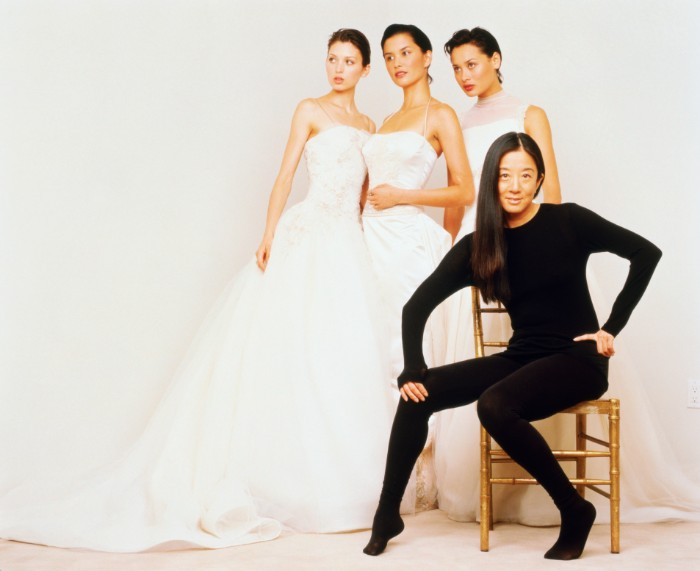 Fashion models wearing wedding dresses by Vera Wang.