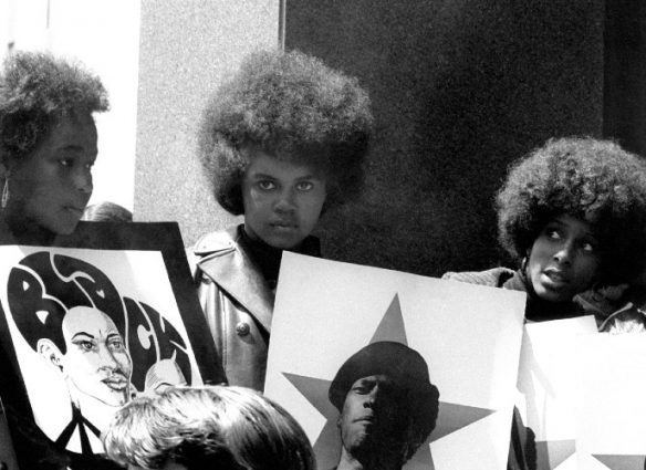 SAN FRANCISCO, CA - MAY 1: A group of women show their support for the Black Panther Party while holding signs with the picture of Minister of Defense Huey P. Newton on May 1, 1969 in San Francisco, California. (Photo by Robert Altman/Michael Ochs Archives/Getty Images)